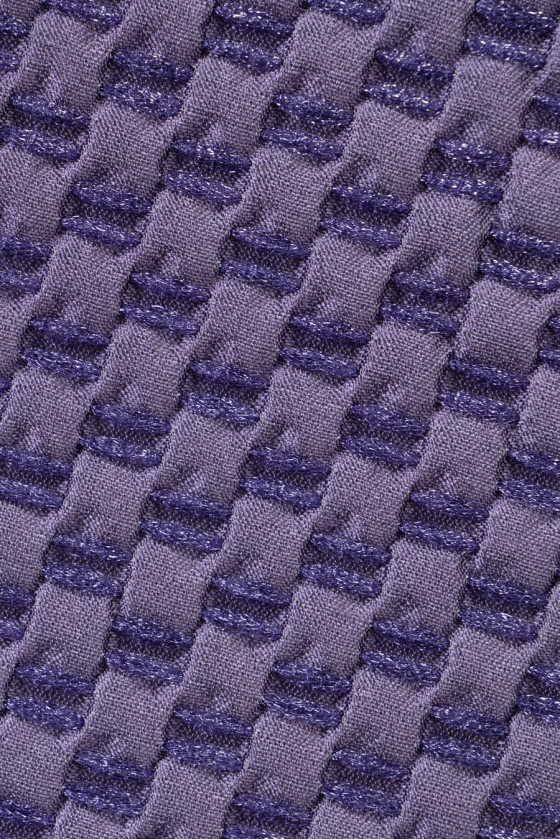 Jacquard with intertwined violet thread