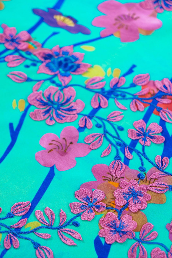 Silk crepe in 3D flowers with green guipure