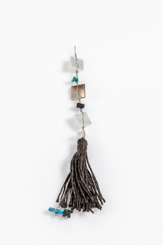 Pendant with tassel and stones
