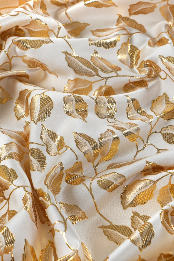 Jacquard fabric in gold leaves